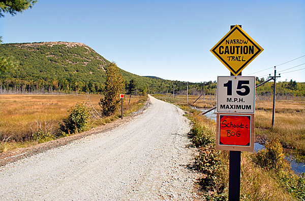 At the western edge of the Schoodic Bog in Sullivan, signs warn outdoor recreationists what to expect while traveling on the Down East Sunrise Trail. Schoodic Mountain rises in the distance.  BANGRO DAILY NEWS PHOOT BY BRIAN SWARTZ