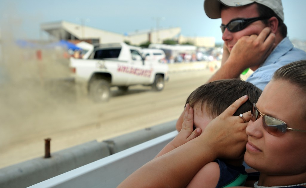 Floyd Wilcox and Michelle Bethune watch the tractor pull competition w ith their son Lance at the Bangor State Fair on Sunday afternoon. They drove from Howland to come to the fair. Although Lance covered his face and his mom covered his ears to protect his hearing, he seemed to like the show.  (BANGOR DAILY NEWS PHOTO BY GABOR DEGRE)  CAPTION  Floyd Wilcox and Mihelle Bethune watch the tractor pull competition with their son Lance, 3 1/2, at the Bangor State Fair Sunday afternoon.  They drove from Howland to come to the fair.  Although Lance covered his face and his mom covered his ears to protet his hearing, he seemed to like the show.   (Bangor Daily News/Gabor Degre)