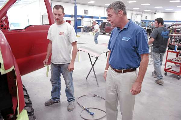 Independent gubernatorial candidate Shawn Moody (right) talks to Eric Conway, a refinishing technician at Moody's Collision Center in Gorham, on Wednesday, Sept. 1, 2010. Moody is mostly known for his chain of auto repair shops in southern Maine but is vying with four other candidates for the Blaine House. (Bangor Daily News/Bridget Brown)