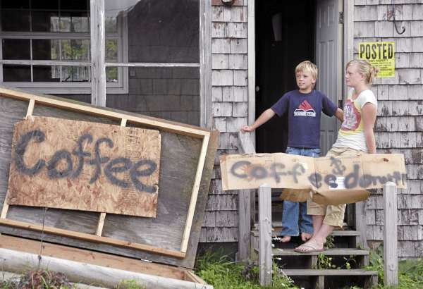 Leah and Joseph Susen stand outside their grandparents? Lee Road home hoping to sell coffee and doughnuts to workers across the street at the Rollins Mountain wind farm site on Wednesday. Construction companies hired by First Wind of Massachusetts began ground-clearing work on the site this week. BDN PHOTOS BY NICK SAMBIDES JR.