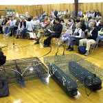 Two oyster-growing cages sit Monday on the floor of the gym at Trenton Elementary School prior to the start of a public hearing on a proposal by local resident Warren Pettegrow to lease two 25-acre portions of Goose Cove for an aquaculture operation. More than 100 people attended Monday's five-hour session of the multi-day hearing, which is being conducted by Maine Department of Marine Resources. BANGOR DAILY NEWS PHOTO BY BILL TROTTER