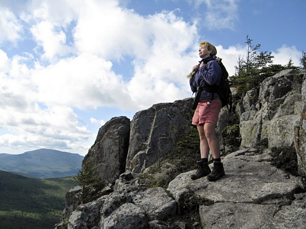Diane Dow watches the clouds blow over the summit of Peak of the Ridges on the Traveler Loop Trail in Baxter State Park on Labor Day. The hike is a ten-mile loop that crosses the three, 3,00 foot summits that form the Traveler range.(Brad Viles photo)