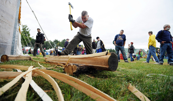 Passamaquoddy Gerald Jacobs slams a brown ash log with the back of an axe head as he demonstrates how to create ash strips for basket making on Friday, September 24, 2010 at the Common Ground Fair in Unity. Jacobs' wife, Kellie, offers hand-woven ash baskets made by Gerald at a nearby table.   BANGOR DAILY NEWS PHOTO BY KEVIN BENNETT