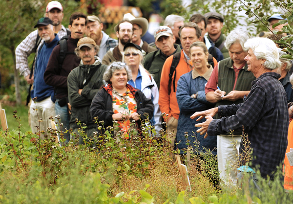 Eric Sideman, right, crop specialist with The Maine Organic Farmers and Gardners Association, lectures a crowd about cover crop selection and management at the Common Ground Fair in Unity on Friday.    BANGOR DAILY NEWS PHOTO BY KEVIN BENNETT
