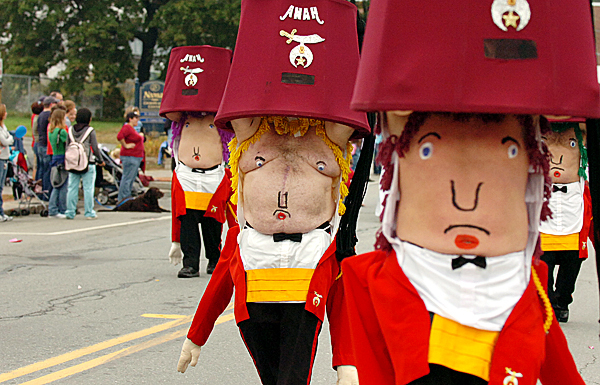 Anah Shrine members including Darrell King of Newport (center) participate in Old Town's Riverfest parade on Saturday morning, Sept. 25, 2010. (Bangor Daily News/Bridget Brown)