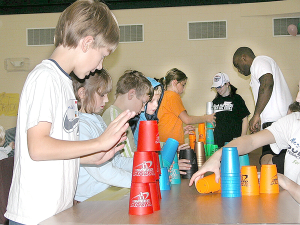 Children at the University of Maine at Presque Isle's Fit and Fun Day participate in a cup stacking game in 2007.  The event,  which was organized by students in the Physical Education Majors Club, is geared toward teaching area children about fitness in a fun environment.  BANGOR DAILY NEWS FILE PHOTO BY JEN LYNDS