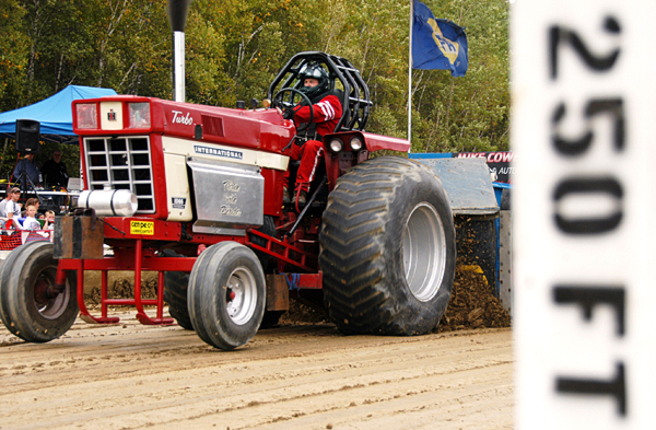 Peter Hurd of Morrill, Maine drivers his tractor, &quotFlirtin' With Disaster,&quot hard during the Northern Timber Cruisers Truck Pull at Millinocket Regional Airport on Saturday. The tractor was digging in to the track so deeply that it could barely keep its front wheels grounded during its run down the track.  BANGOR DAILY NEWS PHOTO BY NICK SAMBIDES JR.