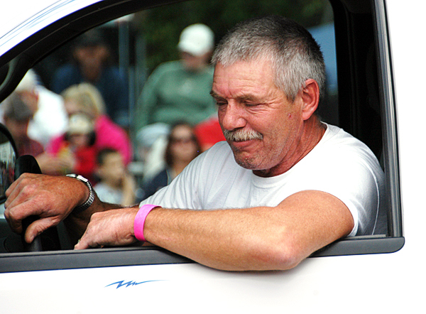 Mike Thompson of Medway grimaces as he finishes his run in his 2008 GMC Sierra pickup truck at the Northern Timber Cruisers Truck Pull at Millinocket Regional Airport on Saturday. &quotEverything is going to run a little bit above me, but you know, I did what I could,&quot he said. BANGOR DAILY NEWS PHOTO BY NICK SAMBIDES JR.
