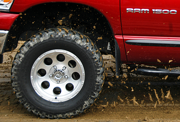 Mud flies from the front wheel of this pickup truck during the Northern Timber Cruisers Truck Pull at Millinocket Regional Airport on Saturday. BANGOR DAILY NEWS PHOTO BY NICK SAMBIDES JR.