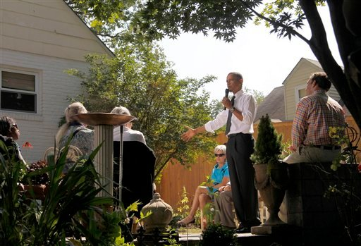 FILE - In this Sept. 22, 2010, file photo President Barack Obama, accompanied by Health and Human Services Secretary Kathleen Sebelius, center, speaks at a private residence in Falls Church, Va. Obama's health care overhaul has divided the nation, and Republicans believe their drive for repeal will help them win elections in November. But the picture's not that clear-cut. An Associated Press poll finds that by more than 2-to-1 Americans, who think the law should have done more, outnumber those who think the government should stay out of health care. (AP Photo/Pablo Martinez Monsivais, File)