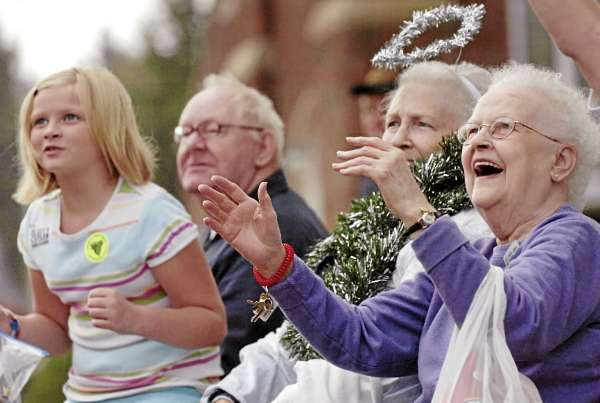Old Town resident Blanche Oakes (right) and Eddington resident Emily Spencer, 8, anticipate a shower of candy at Old Town's Riverfest parade on Saturday morning, Sept. 25, 2010. (Bangor Daily News/Bridget Brown)