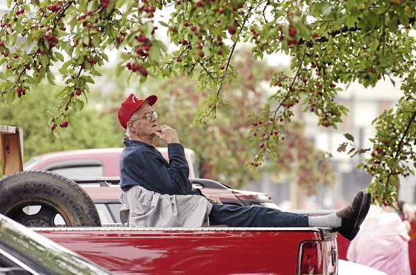 Earnest Welch waits for Old Town's Riverfest parade to begin from atop his truck Saturday morning, Sept. 25, 2010. (Bangor Daily News/Bridget Brown)