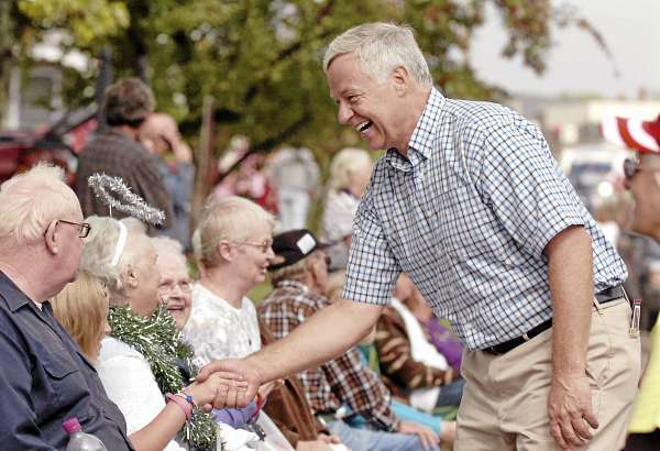 Congressman Mike Michaud greets future voter Emily Spencer, 8, of Eddington alongside others during Old Town's Riverfest parade on Saturday morning, Sept. 25, 2010. (Bangor Daily News/Bridget Brown)