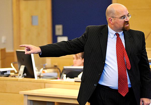 Maine Assistant Attorney General Donald W. McComber points towards defendant Colin Koehler of Bangor as McComber delivers opening arguments for the prosecution team in Koehler's trial at Penobscot Judicial Center Monday. Koehler is accused of fatally stabbing 19-year-old Holly Boutilier of Old Town on Bangor's riverfront in August 2009. (Bangor Daily News/John Clarke Russ)