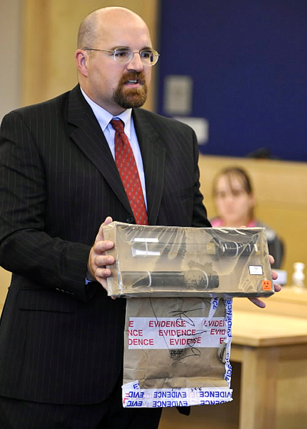 During opening arguments at Penobscot Judicial Center Monday, Sept. 27, 2010, Assistant Attorney General Donald McComber shows the knife that defendant Colin Koehler was accused of using to fatally stab Holly Boutilier in August 2009. (Bangor Daily News/John Clarke Russ)