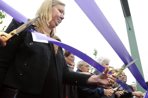 First Lady Karen Baldacci (left) was among the dignitaries who cut the ribbon at the new Educare Center in Waterville Monday.   (Bangor Daily News/Gabor Degre)