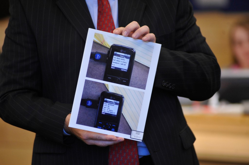 (BANGOR DAILY NEWS PHOTO BY JOHN CLARKE RUSS)  CAPTION  Delivering opening arguments Monday, Sept. 27 at Colin Koehler's jury trial at Penobscot Judicial Center, Assistant Attorney General Donald McComber shows state's evidence photos of a cell phone text that defendant Colin Koehler allegedly sent to a key witness around the time of Holly Boutilier's murder in August 2009.The text reads &quotIve done nothn but adore u every monment i will kill [sic].&quot  (Bangor Daily News/John Clarke Russ)
