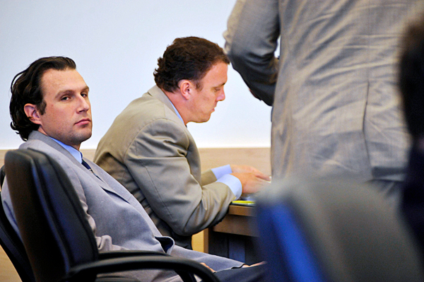 Colin Koehler, left,  of Bangor looks towards seated members of the  prosecution team during the opening arguments of his jury trial at Penobscot Judicial Center Monday. Koehler is accused of  fatally stabbing 19-year-old Holly Boutilier of Old Town on Bangor's riverfront in August 2009. Seated next to him is one of his lawyers, Portland attorney Peter Cyr. (Bangor Daily News/John Clarke Russ)
