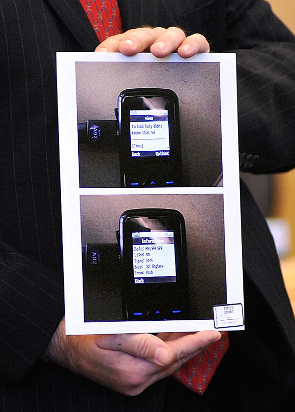 (BANGOR DAILY NEWS PHOTO BY JOHN CLARKE RUSS)CAPTIONDelivering opening arguments Monday , Sept. 27 at Colin Koehler's jury trial at Penobscot Judicial Center, Assistant Attorney General Donald Macomber shows state's evidence photos of a cell phone text that defendant Colin Koehler allegedly sent to a key witness around the time of Holly Boutilier's murder in August 2009.The text reads&quot &quotToo bad Holy [sic] didn't know that lol.&quot  (Bangor Daily News/John Clarke Russ)