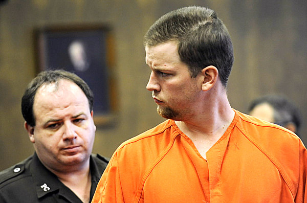 Justin Ptaszynski (right) is escorted from Penobscot County Superio9r Court after making his initial appearance there Thursday afternoon. Police arrested him Thursday in connection with the death of 19-year-old Holly Boutilier, who was found dead in a shed hidden in trees along the Penobscot River in Bangor on Aug. 9. Escorting him from the courtroom is Penobscot County transport officer Troy DeRoche.   (BANGOR DAILY NEWS PHOTO BY JOHN CLARKE RUSS)  