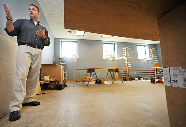 Darryl Lyon (cq) , vice president of the board of directors for the Maine Infantry Foundation, shows off a room at the Brewer Armory that is being remodelled to honor those who have died in military service. The Brewer Armory is home base for the 172nd Infantry (Mountain) Regiment-Bravo Company, Maine Army National Guard in Brewer, Maine. Photographed Sept. 28, 2010. (Bangor Daily News/John Clarke Russ)