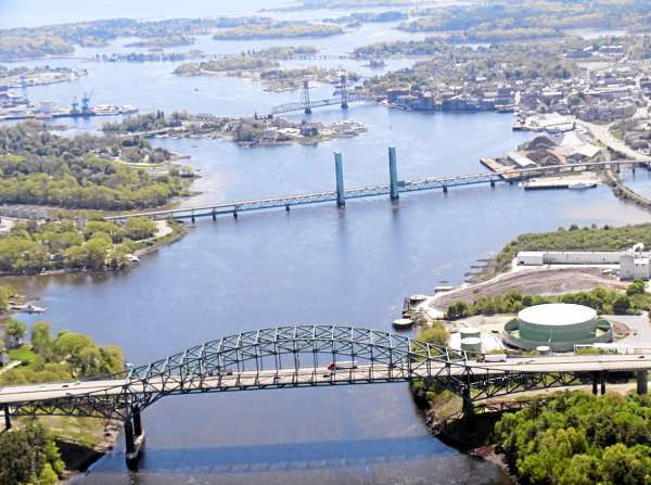The Memorial and Sarah Mildred Long bridges, two of the three bridges that link Maine to New Hampshire over the Piscataqua River, need renovation or replacement. The Interstate Route 95 Pascataqua River Bridge is in the foreground, the Sarah Mildred Long Bridge is in the middle and the Memorial Bridge is at the top. (Photo courtesy of the Maine Department of Transportation)