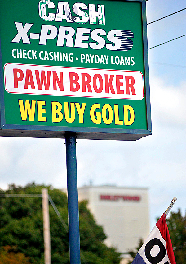 Front signage for  Cash-Xpress on 575 Main Street in Bangor. Bangor Police apprehended a man who came into this pawn shop, check cashing and loan business early Wednesday afternoon.   BANGOR DAILY NEWS PHOTO BY JOHN CLARKE RUSS