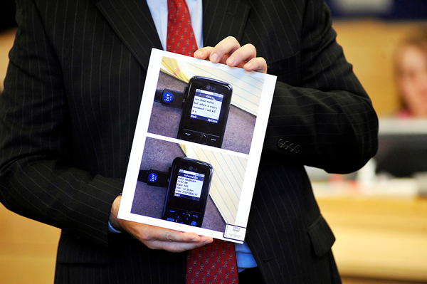 (BANGOR DAILY NEWS PHOTO BY JOHN CLARKE RUSS)CAPTIONDelivering opening arguments Monday, Sept. 27 at Colin Koehler's jury trial at Penobscot Judicial Center, Assistant Attorney General Donald McComber shows state's evidence photos of a cell phone text that defendant Colin Koehler allegedly sent to a key witness around the time of Holly Boutilier's murder in August 2009.The text reads &quotIve done nothn but adore u every monment i will kill [sic].&quot  (Bangor Daily News/John Clarke Russ)