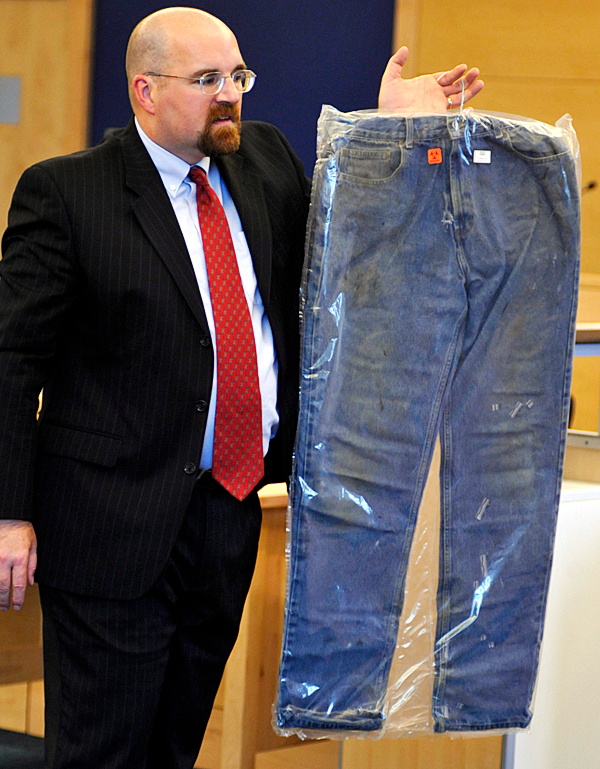 (BANGOR DAILY NEWS PHOTO BY JOHN CLARKE RUSS)CAPTIONAssistant Attorney General Donald Macomber shows a pair of pants allegedly belonging to defendant Colin Koehler as McComber delivers the prosecution's opening arguments at the start of Colin Koehler's jury trial at Penobscot Judicial Center Monday, Sept. 27. Koehler is accused of fatally stabbing 19 year-old Holly Boutilier of Old Town on Bangor's riverfront in August 2009. (Bangor Daily News/John Clarke Russ)