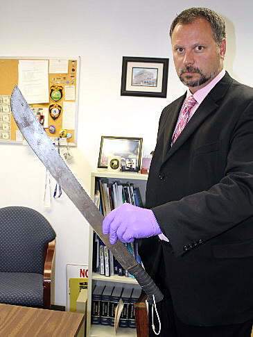 Rockland Police Detective Russ Thompson displays the two-foot-long machete that a man wielded as he tried to steal drugs this morning from the Main Street Rite Aid, according to police.  At about 10:26 a.m., Joshua Powell, 23, of Rockland walked into the Rite Aid with a machete, jumped over the pharmacy counter, showed the pharmacist the machete and demanded drugs, according to Deputy Chief of Police Wally Tower. (Bangor Daily News/Heather Steeves)