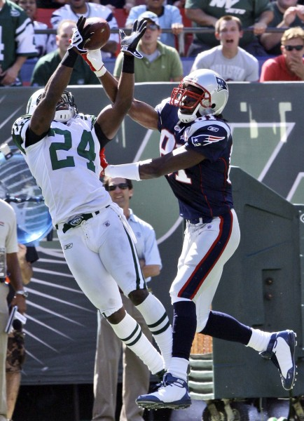 In this Sept. 20, 2009, file photo, New York Jets cornerback Darrelle Revis (24) intercepts the ball as New England Patriots wide receiver Randy Moss (81) attempts to catch a pass from quarterback Tom Brady during the first quarter of an NFL football game in East Rutherford, N.J. Revis is ready for Moss. The New York Jets cornerback and the New England wide receiver will be able to take their trash talking to the field when their teams meet Sunday.