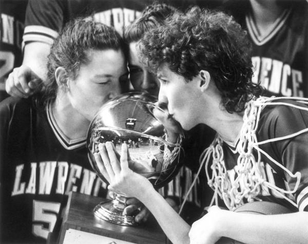 LAWRENCE PLAYERS Janet Francoeur, Wendy Atwood and Cindy Blodgett kiss the Class A basketball trophy after winning their school's fourth straight schoolgirl championship in 1994.