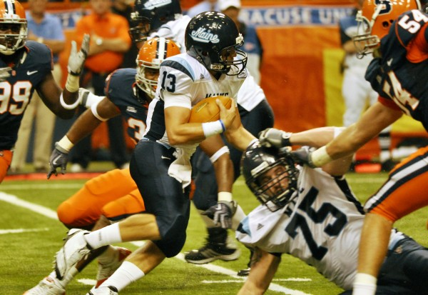 Maine quarterback Warren Smith (13) scores a touchdown against Syracuse during the first quarter of an NCAA college football game in Syracuse, N.Y., Saturday, Sept. 18, 2010. (AP Photo/Kevin Rivoli)