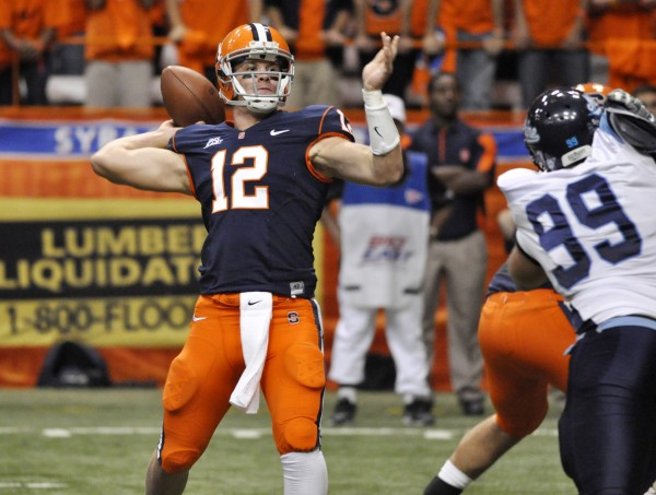 Syracuse quarterback Ryan Nassib throws a touchdown pass against Maine during the second quarter of an NCAA college football game in Syracuse, N.Y., Saturday, Sept. 18, 2010. (AP Photo/Kevin Rivoli)