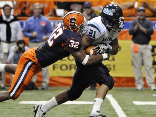 Syracuse's Doug Hogue, left, tackles Maine's Jared Turcotte from behind during the second quarter of an NCAA college football game in Syracuse, N.Y., Saturday, Sept. 18, 2010. (AP Photo/Kevin Rivoli)