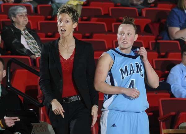 Maine Coach Cindy Blodgett gives instructions to her team as Kristin Baker looks on. (BDN file photo)