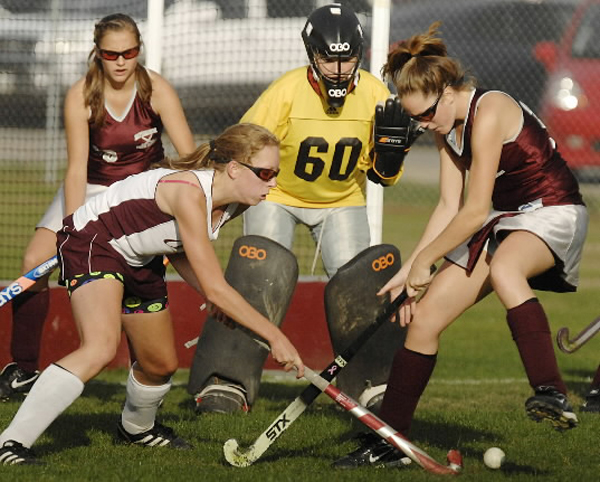 Mattanawcook's Harli Maxwell (left) introduces the ball to Orono's Sherriah Grace during the second half of their high school field hockey game in Orono Tuesday. The Red Riots won 2-0.
