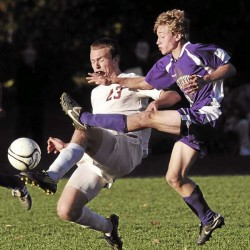 Bangor High School's Phil Frost (left) and Waterville High School's John Terhune battle for the ball during the second half of Tuesday's boys soccer game in Bangor.