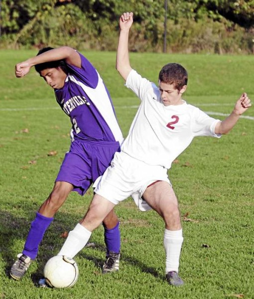 Bangor High School's Chayce Beck (right) and Waterville High School's Matt Lynch battle for the ball during the first half of their boys soccer game in Bangor on Tuesday afternoon.