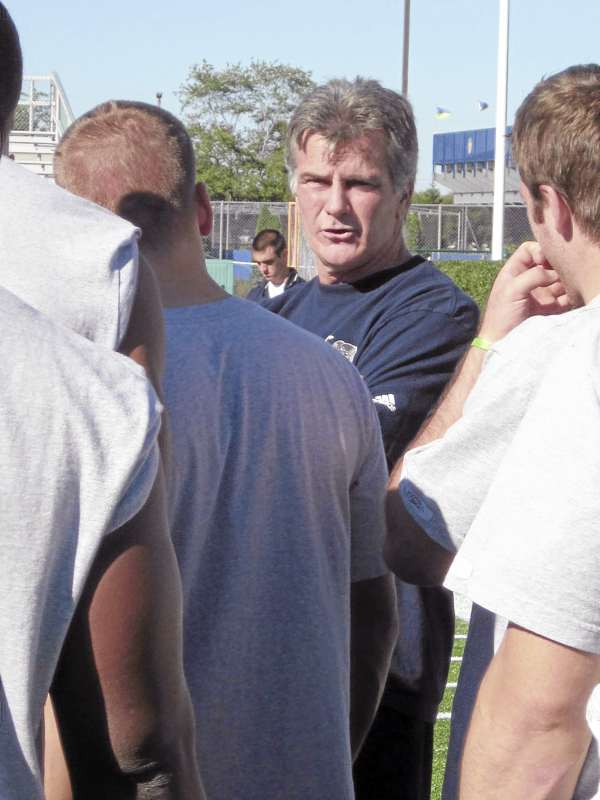 University of Maine football coach Jack Cosgrove talks to the team to wrap up Friday's light workout at Delaware Stadium in Newark, Del. The Black Bears take on No. 2 Delaware on Saturday at 1 p.m. (Bangor Daily News Photo/Pete Warner)