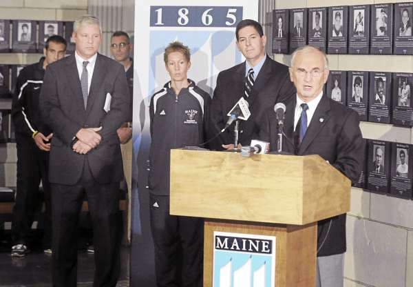 University of Maine President Robert Kennedy (right), flanked by (from left) interim athletic director Steve Abbott, women's basketball coach Cindy Blodgett and men's basketball coach Ted Woodward, talks about a $5.5 million gift from the Harold Alfond Foundation during a Friday morning press conference in Orono. The money will go toward improvements at Alfond Arena and the Memorial Gym.