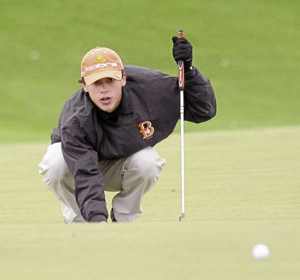 Brewer High School's Tyler White lines up a shot on the second hole during the High School Individual Chanmpionship at the Natanis Golf Club in Vassalboro Saturday. White shot an 84. (Bangor Daily News/Gabor Degre)