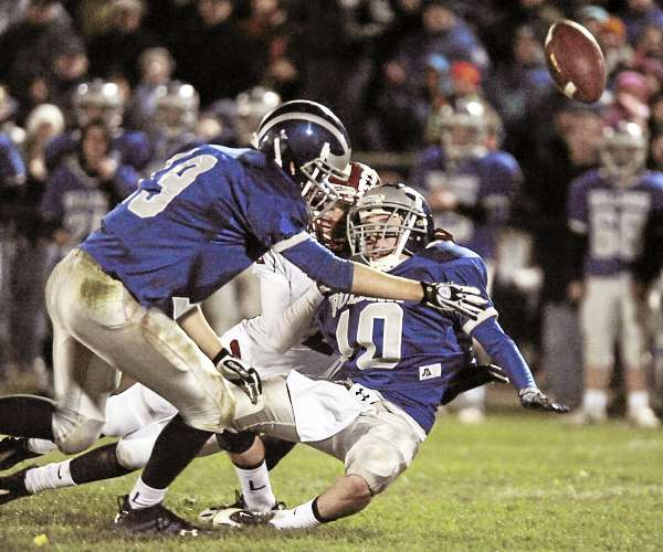 Lawrence free safety Alex Leathers (19) and teammate Devan Belanger break up a pass intended for Bangor's Carl Farnham in the fourth quarter of their game in Fairfield Saturday, Oct. 16, 2010. Bangor Daily News/Michael C. York