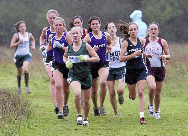 Old Town High School's Dacie Manion leads a tightly-bunched pack during the Penobscot Valley Conference cross country championship meet in Bangor Saturday. Manion went on to finish in first place with a time of 19 minutes, 7.6 seconds. (BDN Photo by Jason Smith)