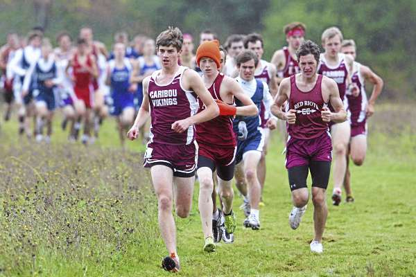Caribou's Christian Sleeper leads the way early in the Penobscot Valley Conference cross country championship meet in Bangor Saturday. Ellsworth's Dan Curts (in hat) went on to win the race but Sleeper's Vikings won the team title. (BDN Photo by Jason Smith)