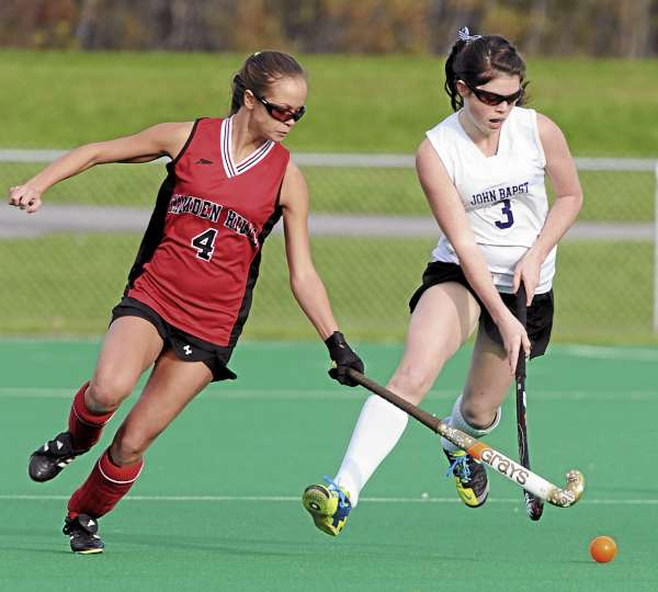 Camden Hills' Shawna Kelly (left) and John Bapst's Elise Tilton battle for control of the ball at the University of Maine in Orono on Tuesday, Oct. 19, 2010 during Eastern Maine Class B quarterfinal field hockey action. (Bangor Daily News/Kevin Bennett)