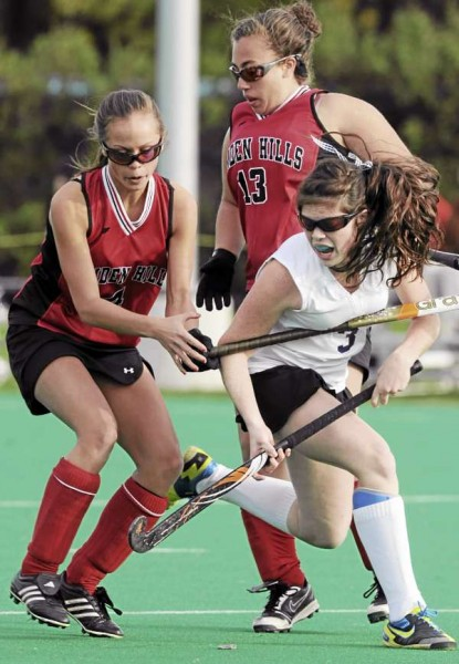 John Bapst's Elise Tilton (right) gets trapped by Camden Hills Shawna Kelly (left) and Mia Bergman (center) at the University of Maine onTuesday, Oct. 19, 2010 during Eastern Maine Class B quarterfinal field hockey action. (Bangor Daily News/Kevin Bennett)