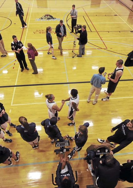 Media from Bangor and across the state descended Wednesday on the University of Maine's Memorial Gym, where the coaches and players of the Black Bears' basketball teams were available for interviews.