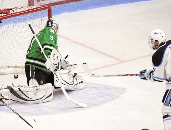 Maine's Robby Dee (right) fires a one-timer past North Dakota goalie Brad Eidsness (31) for a score in the first period of their NCAA  college hockey game, Friday, Oct. 22, 2010, in Orono, Maine. (AP Photo/Michael C. York)