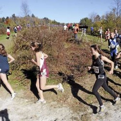 Competitors negotiate a tight turn on the course during the Eastern Maine Class B cross country regional at the Troy Howard Middle School in Belfast Saturday. John Bapst won the team title. (Bangor Daily News/Gabor Degre)